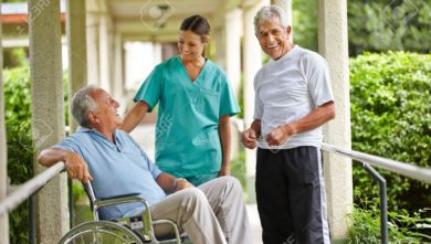17660204-Two-happy-senior-people-taking-to-a-nurse-in-a-nursing-home-Stock-Photo