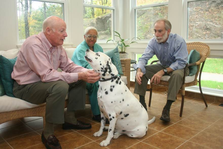 Sophia Snow House residents enjoying time with a dog.