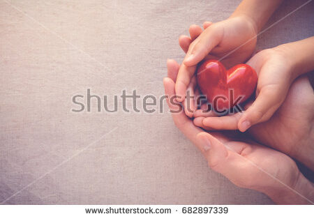 stock-photo-adult-and-child-hands-holding-red-heart-health-care-donate-and-family-insurance-concept-world-682897339